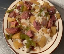 Plated pineapples and ham on rice